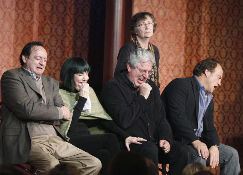 """FILE - In this Dec. 12, 2009 file photo, actor and director Harold Ramis, center, along with actors from left, Joe Flaherty, Eugenie Ross-Leming, Judy Morgan, standing, and Jim Belushi break out in laughter as they perform a skit on stage to celebrate The Second City's 50th anniversary in Chicago. An attorney for Ramis said the actor died Monday morning, Feb. 24, 2014, from complications of autoimmune inflammatory disease at his home in Glencoe, Ill. He was 69. Ramis is best known for his roles in the comedies """"Ghostbusters"""" and """"Stripes."""" (AP Photo/Jim Prisching, File)"""