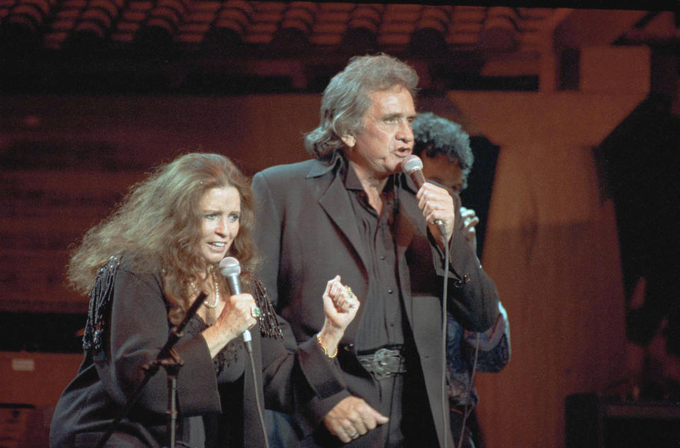 """FILE - In this Oct. 16, 1992, file photo, singers Johnny Cash and his wife June Carter Cash perform at New York's Madison Square Garden. The Man in Black is about to get his own day in Arkansas. The Arkansas House on Tuesday, April 20, 2021, gave unanimous final approval to a bill that would make Feb. 26 """"Johnny Cash Day,"""" sending it to Gov. Asa Hutchinson, who plans to sign it. AP Photo/Ron Frehm, File)"""
