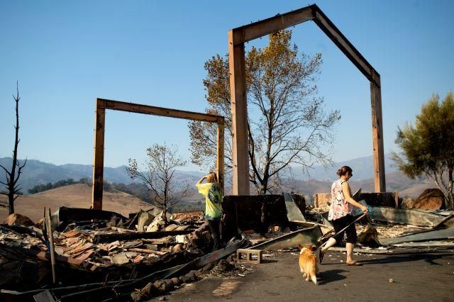 Stephanie LaFranchi, right, and Ashley LaFranchi examine the remains of their family's Oak Ridge Angus ranch, leveled by the Kincade Fire, in Calistoga on Oct. 28.