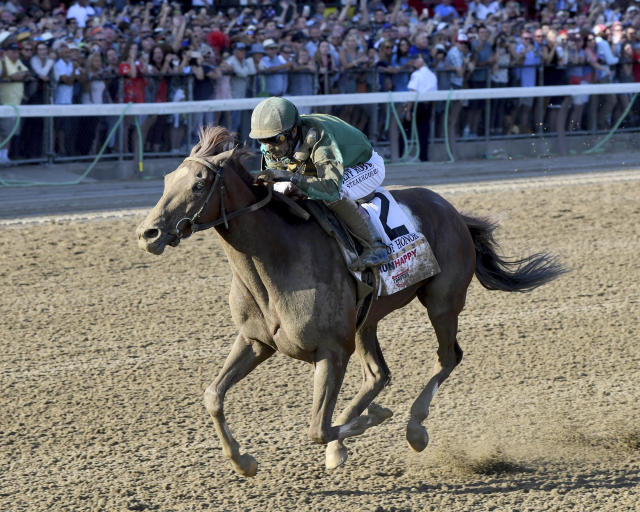 In a photo provided by the NYRA, Code of Honor, with jockey John Velazquez, wins the Travers Stakes horse race Saturday, Aug. 24, 2019, at Saratoga Race Course in Saratoga Springs, N.Y. (Coglianese Photos/NYRA via AP)