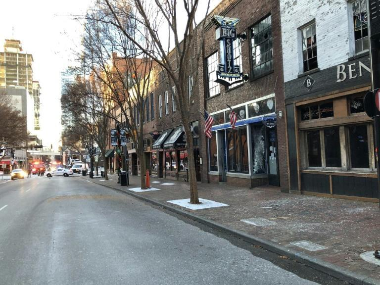 In this photo from the Twitter page of the Nashville Fire Department, damage is seen on a street after the explosion