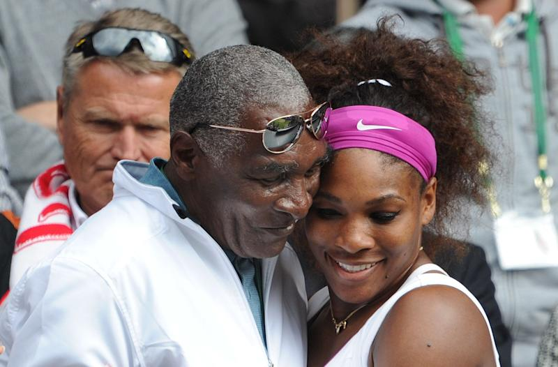 Serena Williams hugs her father, Richard Williams, after winning her Ladies Singles Final match at the 2012 Wimbledon Tennis Championships in London.