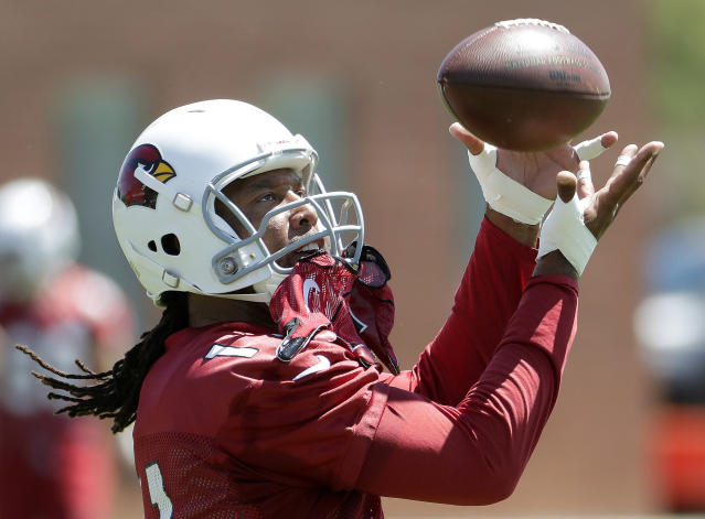 Arizona Cardinals ' Larry Fitzgerald (11) makes a catch during practice at the NFL football team's training camp Thursday, June 7, 2018, in Tempe, Ariz. (AP Photo/Matt York)