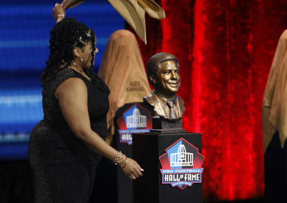 Cydney Nunn unveils the bust of her grandfather Bill Nunn during a Pro Football Hall of Fame Enshrinement ceremony in April. (Tom E. Puskar/AP Images for NFL)