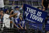 Los Angeles Dodgers fans watch during the seventh inning in Game 1 of the baseball World Series against the Tampa Bay Rays Tuesday, Oct. 20, 2020, in Arlington, Texas. (AP Photo/Eric Gay)