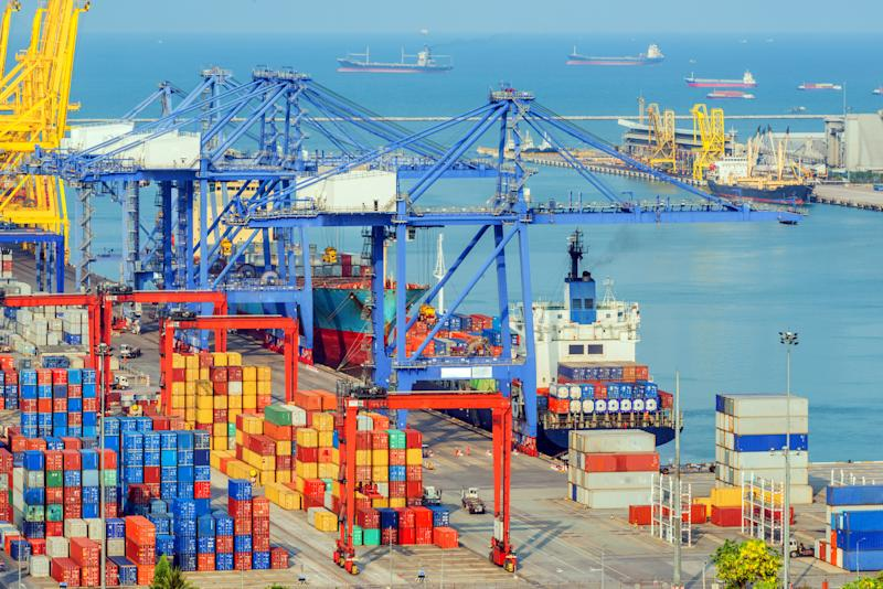 Cargo containers and cranes at a port