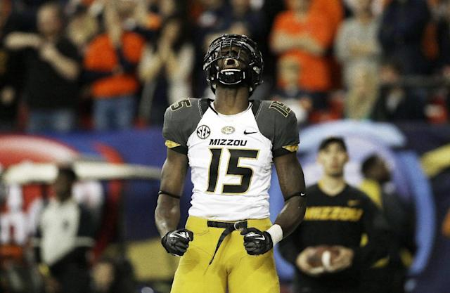 FILE - In this Dec. 7, 2013, file photo, Missouri wide receiver Dorial Green-Beckham celebrates his touchdown against Auburn during the first half of the Southeastern Conference NCAA college football championship game in Atlanta. Dorial Green-Beckham was suspended indefinitely Monday, April 7, 2014, for an unspecified violation of team rules, three months after he and two friends were arrested on suspicion of felony drug distribution when police found a pound of marijuana in their car. Coach Gary Pinkel announced the suspension without mentioning the January incident in which the standout receiver was arrested in his Missouri hometown of Springfield. (AP Photo/John Bazemore, File)