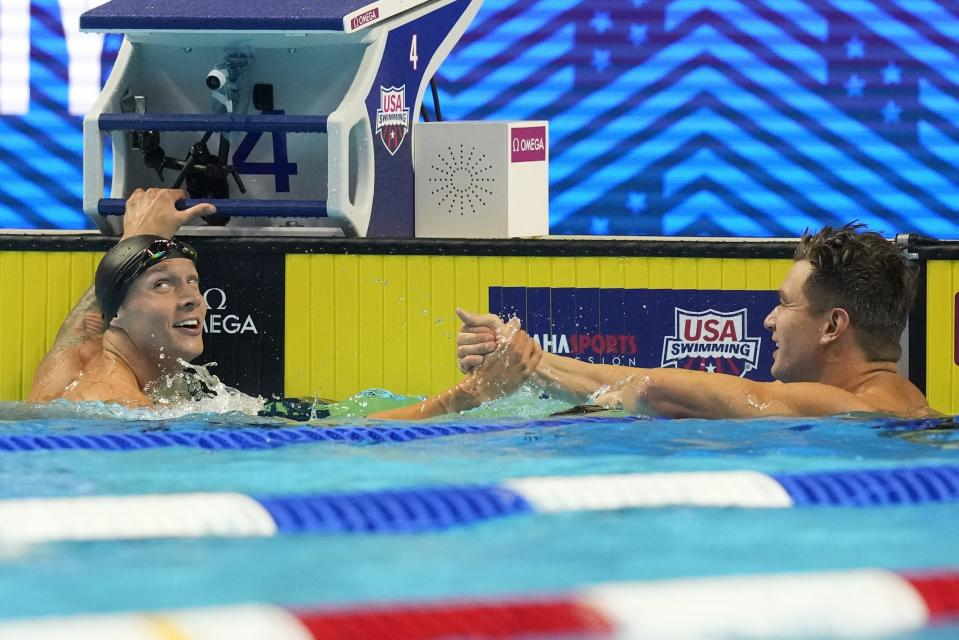 Nathan Adrian congratulates Caeleb Dressel after the men's 50 freestyle during wave 2 of the U.S. Olympic Swim Trials on Saturday, June 19, 2021, in Omaha, Neb. (AP Photo/Charlie Neibergall)
