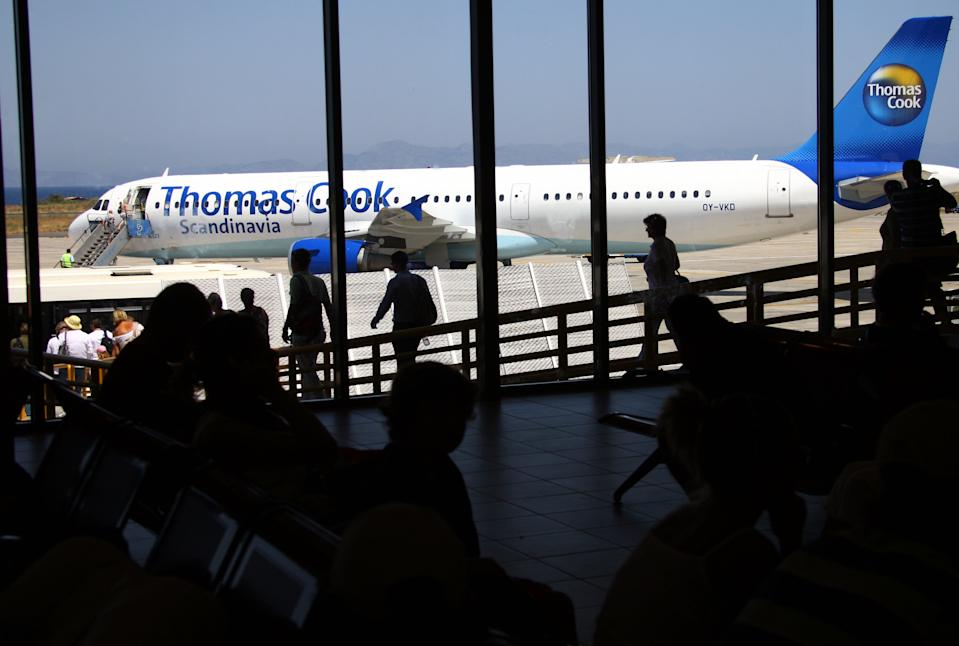 RHODES ISLAND - AUGUST 10:  Passengers wait for boarding on a Thomas Cook Passenger jet at the Airport on August 10, 2008 in Rhodes, Greece. Rhodes is the largest of the greek Dodecanes Islands.  (Photo by EyesWideOpen/Getty Images)
