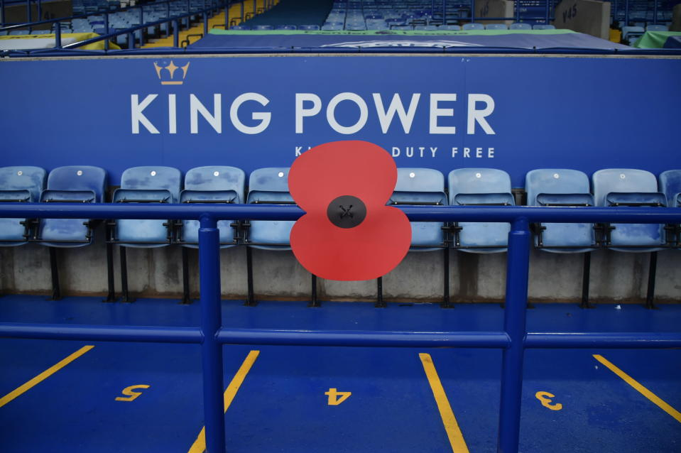 A giant poppy to mark Remembrance Sunday decorating the stands before the English Premier League soccer match between Leicester City and Wolverhampton Wanderers at the King Power Stadium in Leicester, England, Sunday, Nov. 8, 2020. (AP Photo/Rui Vieira, Pool)