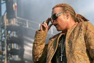 <p>Rock stars like Guns N' Roses frontman Axl Rose are known for wild haircuts, but this odd braided style with a red and yellow pattern is not his best look.</p>