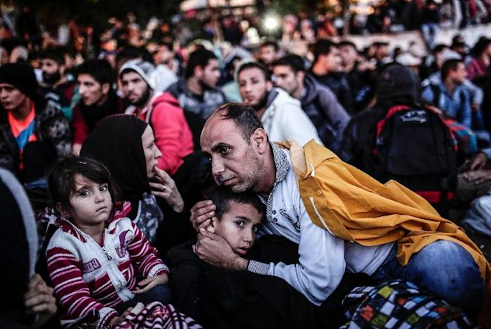 Migrants and refugees waiting at the Esenler Bus Terminal, Istanbul, for buses to the Turkish-Greek border (AFP Photo/Yasin Akgul)
