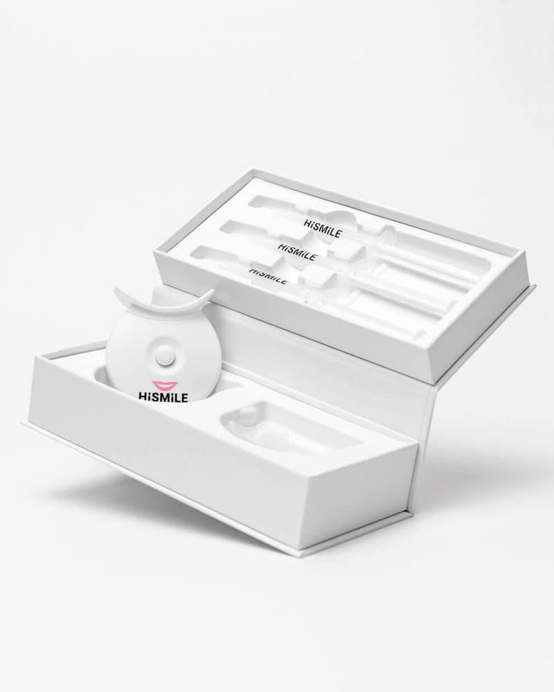 """<p>hismileteeth.com</p><p><strong>$129.00</strong></p><p><a href=""""https://us.hismileteeth.com/products/teeth-whitening-kit"""" rel=""""nofollow noopener"""" target=""""_blank"""" data-ylk=""""slk:Shop Now"""" class=""""link rapid-noclick-resp"""">Shop Now</a></p><p>Those whose teeth are prone to sensitivity will love the HiSmile home teeth-whitening kit. """"HiSmile uses Pthalimidoperoxycaproic acid (PAP) as its principal whitening agent, as opposed to the more traditional and harsher peroxides, so those patients who tend to experience sensitivity will fare better with this product,"""" says Kunen. This top teeth-whitening kit comes with easy-to-use syringes of gel that are dispensed into a mouth tray that has a blue LED light attached to it.</p>"""