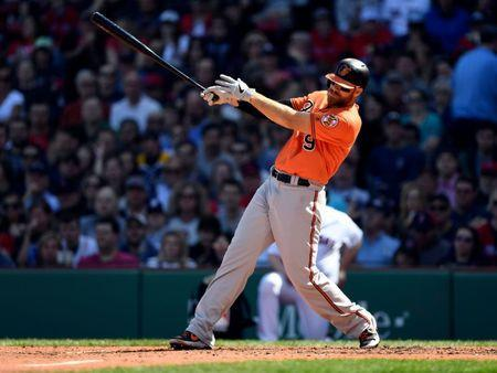 Apr 13, 2019; Boston, MA, USA; Baltimore Orioles first baseman Chris Davis (19) hits an RBI double against the Boston Red Sox during the fifth inning at Fenway Park. Mandatory Credit: Brian Fluharty-USA TODAY Sports