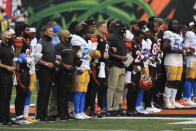 The Cincinnati Bengals and Los Angeles Chargers stand together arm in arm before for an NFL football game, Sunday, Sept. 13, 2020, in Cincinnati. (AP Photo/Aaron Doster)