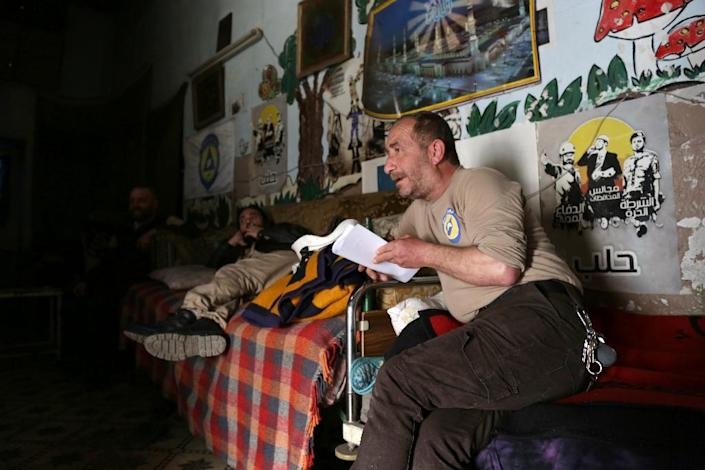 Syrian emergency personnel talk at their centre on February 29, 2016 in the Bab al-Nairab neighborhood of Syria's second city Aleppo (AFP Photo/Karam al-Masri)