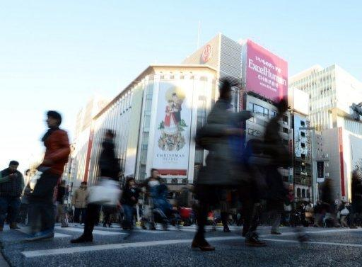 Japan data confirms economy shrinks 0.9% in July-Sept