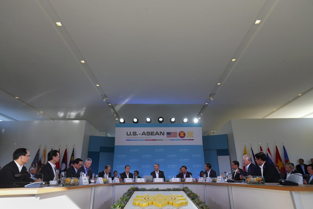 U.S. President Barack Obama (C) addresses leaders at a 10-nation Association of Southeast Asian Nations (ASEAN) summit in Rancho Mirage, California February 15, 2016. Obama is expected to press leaders from Southeast Asia to boost trade and back a common stance on the South China Sea.  The leaders (L to R) Le Luong Minh, Secretary General of the Association of Southeast Asian Nations, Vietnam Prime Minister Nguyen Tan Dung, Thailand Prime Minister Prayuth Chan-ocha, Singapore Prime Minister Lee Hsien Loong, Philippine President Benigno Aquino,  Laos President Choummaly Sayasone, U.S. President Barack Obama, Sultan of Brunei Hassanal Bolkiah, Cambodia Prime Minister Hun Sen, Indonesian President Joko Widodo, Malaysia Prime Minister Najib Razak and Myanmar Vice President U Nyan Tun.  REUTERS/Mike Blake