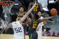 Baylor's Jared Butler (12) attempts a shot over Washington's Riley Sorn (52) during the second half of an NCAA college basketball game Sunday, Nov. 29, 2020, in Las Vegas. (AP Photo/John Locher)