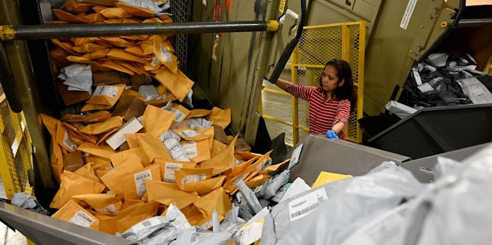 "Marianne Isaac works to help sort over 7000 pieces of mail on a small parcel sorter system machine during a behind the scenes tour at the USPS Distribution Center in the City of Industry, California.  <p class=""copyright"">Keith Birmingham/Digital First Media/Pasadena Star-News via Getty Images)</p> <p>"