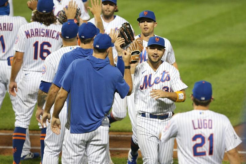 Mets celebrate a win with high fives Michael Conforto