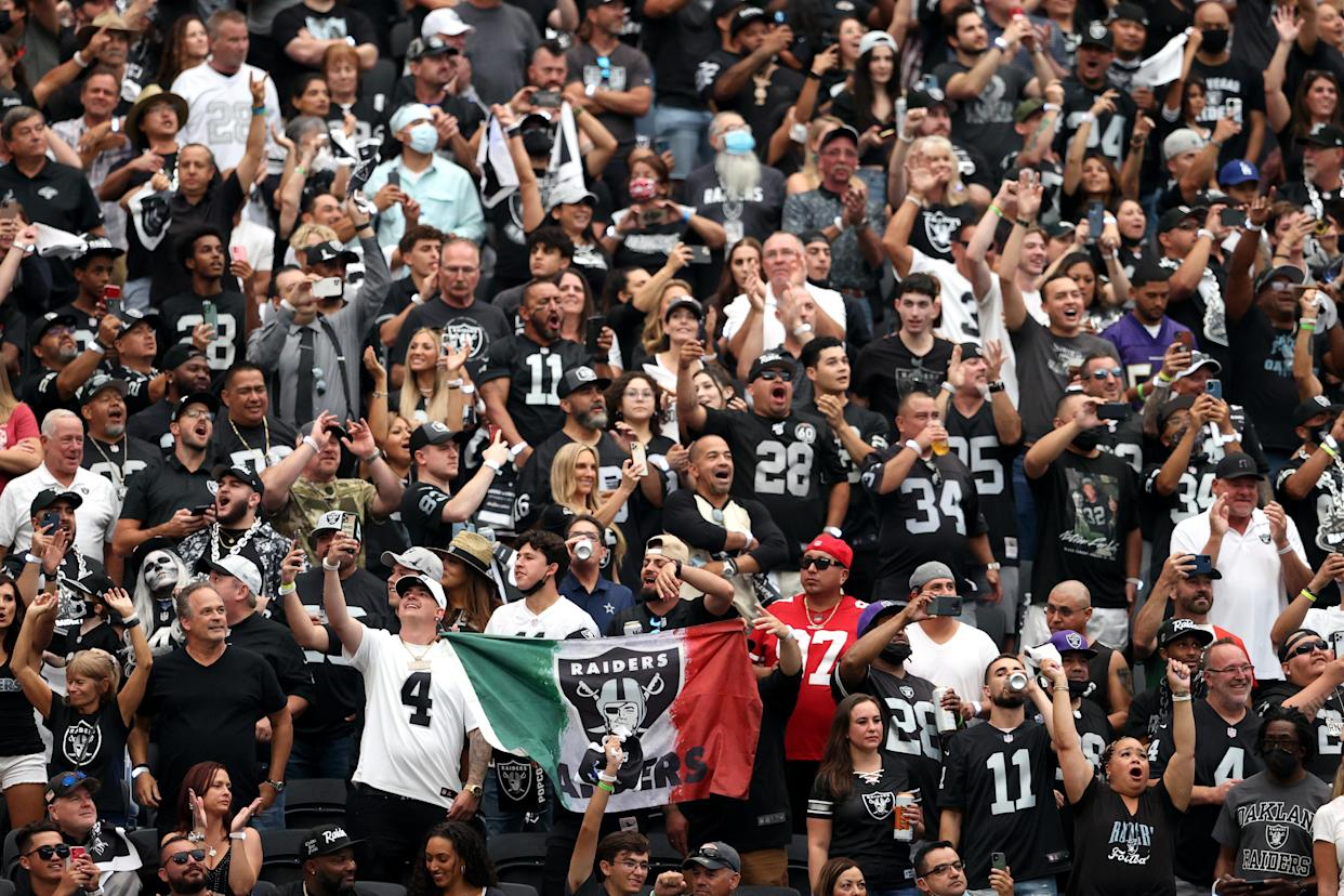 LAS VEGAS, NEVADA - SEPTEMBER 13: Las Vegas Raiders fans cheer during the game between the Raiders and the Baltimore Ravens at Allegiant Stadium on September 13, 2021 in Las Vegas, Nevada. (Photo by Christian Petersen/Getty Images)