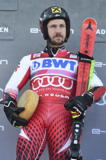 First placed Austria's Marcel Hirscher stands on the podium at the end of a ski World Cup men's Giant Slalom in Adelboden, Switzerland, Saturday, Jan. 12, 2019. (AP Photo/Marco Tacca)