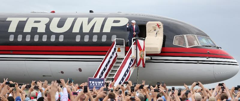 Republican presidential nominee Donald Trump pumps his fist to supporters at the conclusion of his campaign event on the tarmac at Lakeland Linder Regional Airport in Lakeland, Florida on October 12, 2016