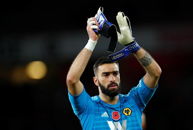 """Soccer Football - Premier League - Arsenal v Wolverhampton Wanderers - Emirates Stadium, London, Britain - November 11, 2018 Wolverhampton Wanderers' Rui Patricio applauds the fans after the match REUTERS/Eddie Keogh EDITORIAL USE ONLY. No use with unauthorized audio, video, data, fixture lists, club/league logos or """"live"""" services. Online in-match use limited to 75 images, no video emulation. No use in betting, games or single club/league/player publications. Please contact your account representative for further details."""