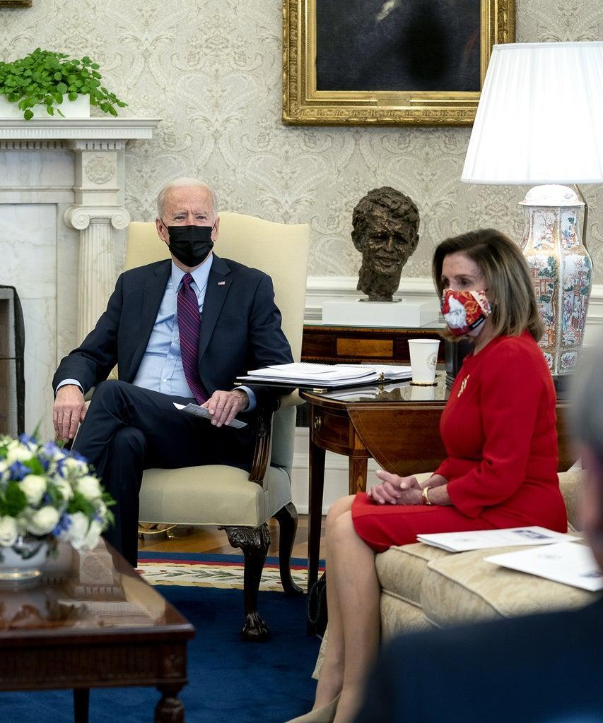 U.S. President Joe Biden, center, U.S. Vice President Kamala Harris, left, and U.S. House Speaker Nancy Pelosi, a Democrat from California, wear protective masks during a meeting in the Oval Office of the White House in Washington, D.C., U.S., on Friday, Feb. 5, 2021. The Senate voted 51-50 to adopt a budget blueprint for Biden's $1.9 trillion virus relief package following nearly 15 hours of wading through amendments from both parties. Photographer: Stefani Reynolds/The New York Times/Bloomberg via Getty Images