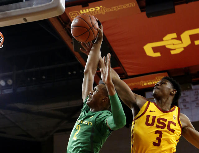 Oregon's Louis King, goes to basket and is fouled by Southern California's Elijah Weaver during the first half of an NCAA college basketball game Thursday, Feb. 21, 2019, in Los Angeles. (AP Photo/Ringo H.W. Chiu)