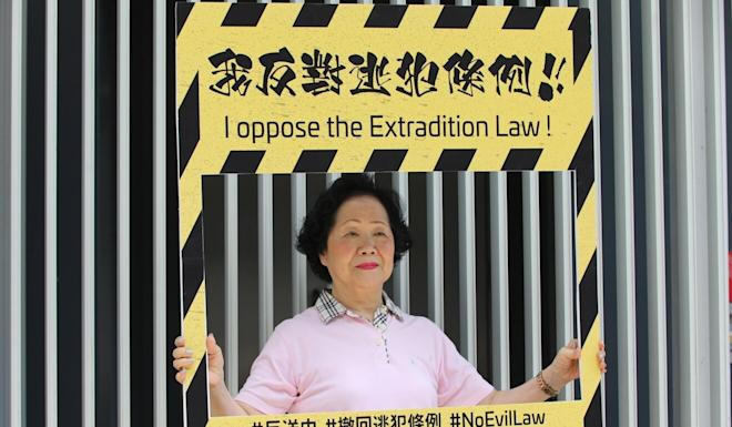 Anson Chan, who on Friday announced she was stepping back from politics, holds a sign opposing the extradition law outside government headquarters in Hong Kong's Admiralty area in June 2019. Photo: Handout