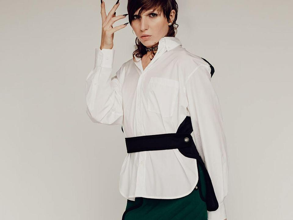 """Balenciaga Cotton Shirt With Vest, $805, available at MyTheresa; Balenciaga Scuba Skirt, $1,015, available at MyTheresa; model's own necklace. <span class=""""copyright"""">Photographed by David Urbanke. </span>"""