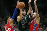 Boston Celtics' Jayson Tatum (0) loses control of the ball against Philadelphia 76ers' Matisse Thybulle (22) and Mike Scott (1) during the second half of an NBA basketball game in Boston, Saturday, Feb. 1, 2020. (AP Photo/Michael Dwyer)