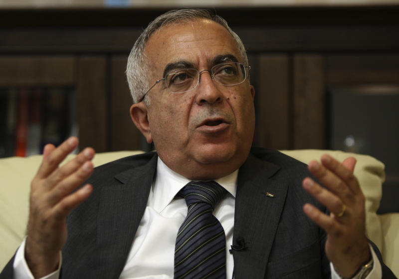 FILE - In this  June 28, 2011 file photo, Palestinian Prime Minister Salam Fayyad speaks during an interview with The Associated Press in the West Bank city of Ramallah. Palestinian officials said Thursday, April 11, 2013, that Fayyad offered his resignation to President Mahmoud Abbas as part of an increasingly bitter conflict over authority. (AP Photo/Majdi Mohammed, File)