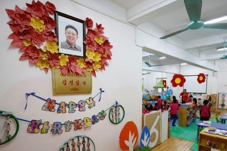 Vietnamese children play in front of a portrait of late North Korea's leader Kim Il at the Vietnam-North Korea Friendship kindergarten, founded by North Korean Government in 1978 in Hanoi, Vietnam February 13, 2019. REUTERS/Kham
