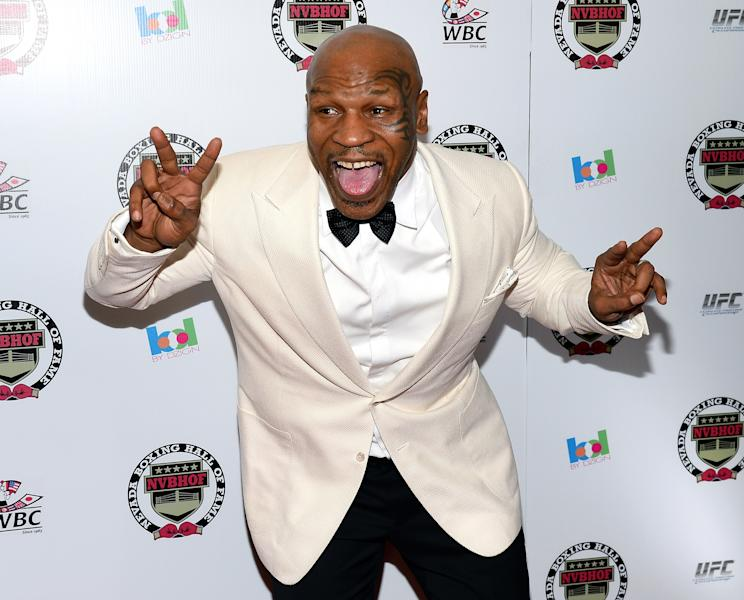 LAS VEGAS, NV - AUGUST 10: Former boxer and inductee Mike Tyson arrives at the Nevada Boxing Hall of Fame inaugural induction gala at the Monte Carlo Resort and Casino on August 10, 2013 in Las Vegas, Nevada. (Photo by Ethan Miller/Getty Images)