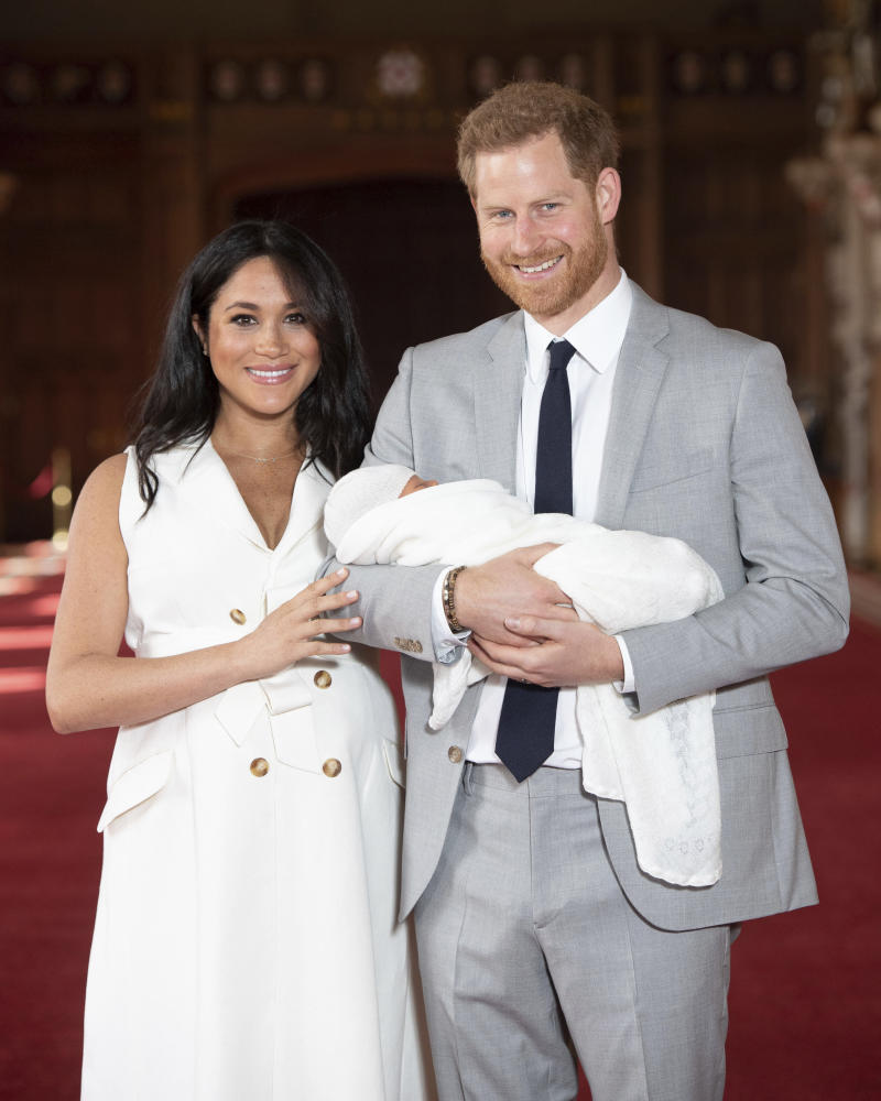 "January 20th 2020 - Buckingham Palace has announced that Prince Harry and Duchess Meghan will no longer use ""royal highness"" titles and will not receive public money for their royal duties. Additionally, as part of the terms of surrendering their royal responsibilities, Harry and Meghan will repay the $3.1 million cost of taxpayers' money that was spent renovating Frogmore Cottage - their home near Windsor Castle. - January 9th 2020 - Prince Harry The Duke of Sussex and Duchess Meghan of Sussex intend to step back their duties and responsibilities as senior members of the British Royal Family. - File Photo by: zz/KGC-375/STAR MAX/IPx 2019 5/8/19 Prince Harry The Duke of Sussex and Meghan The Duchess of Sussex with their baby son, who was born on Monday morning May 6th, at a photocall in St. George's Hall at Windsor Castle in Berkshire."