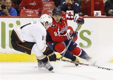 Washington Capitals right wing Alex Ovechkin (8) skates with the puck in front of Anaheim Ducks center Saku Koivu (11) in the first period at Verizon Center. Geoff Burke-USA TODAY Sports
