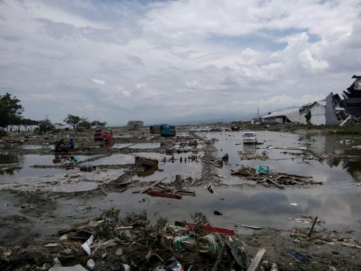 <p>The ruins of cars as seen after tsunami hit in Palu, Indonesia on Sept. 29, 2018. (Photo: Stringer/Reuters) </p>