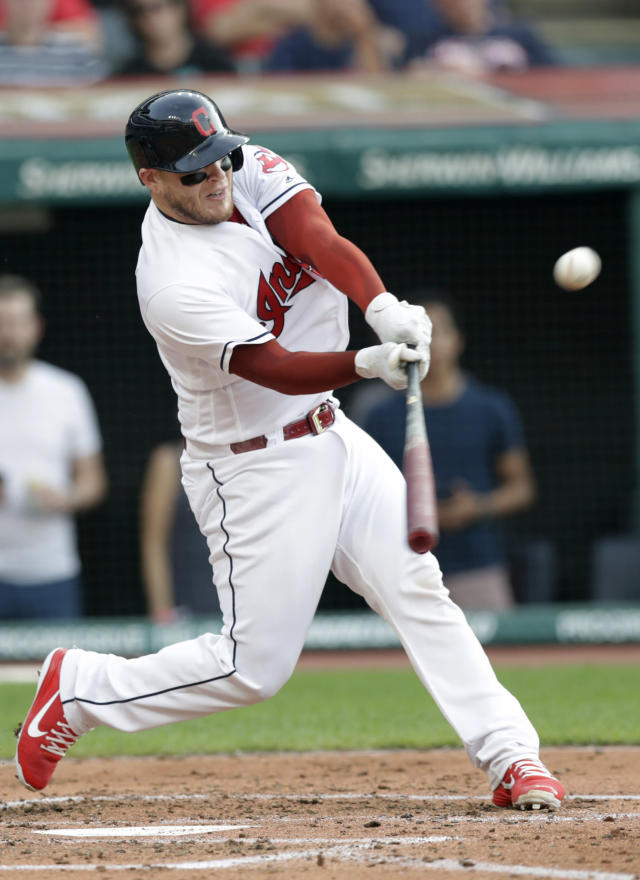 Cleveland Indians' Roberto Perez hits a ground rule double off Chicago White Sox starting pitcher Dylan Covey in the second inning of a baseball game, Monday, June 18, 2018, in Cleveland. Lonnie Chisenhall and Rajai Davis scored on the play. (AP Photo/Tony Dejak)