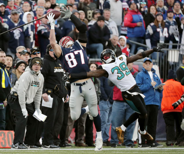 Jacksonville Jaguars safety Tashaun Gipson (39) breaks up a pass intended for New England Patriots tight end Rob Gronkowski (87) during the first half of the AFC championship game on Sunday. (AP)