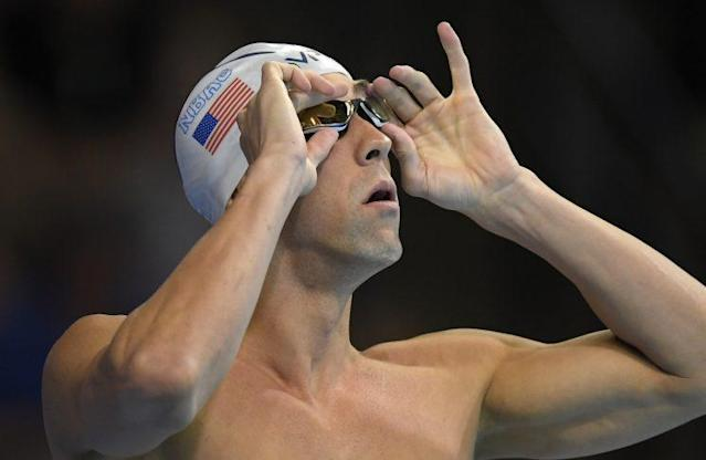 Michael Phelps adjusts his goggles before his heat in the men's 200-meter individual medley preliminaries at the U.S. Olympic swimming trials. (AP)