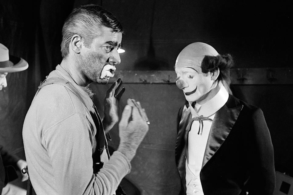 "US comedian, director and singer Jerry Lewis (L) talks to Pierre Etaix, on March 22, 1972, during the shooting of the film ""The Day the Clown cried"" he directed at the Cirque D'Hiver in Paris. Born in 1926, Jerry Lewis appeared in about fifty films in the 50s and 60s such as ""My friend Irma"" with Dean Martin and directed different films such as ""the Nutty Professor"". In the 70s he mainly acted in TV shows and the theater. (Photo credit should read STF/AFP via Getty Images)"