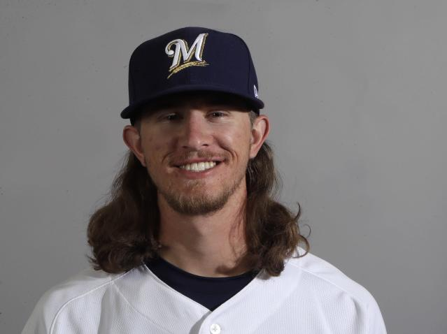 Josh Hader pitches with his hair on fire (AP Photo/Carlos Osorio)