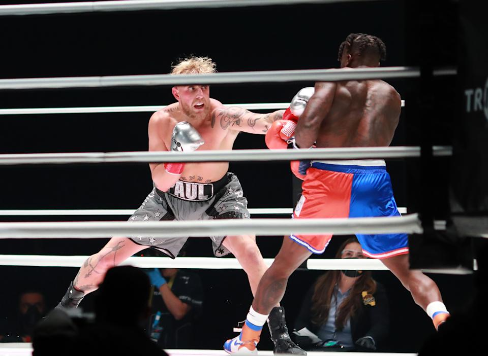 LOS ANGELES, CALIFORNIA - NOVEMBER 28: Jake Paul throws a punch against Nate Robinson in the first round during Mike Tyson vs Roy Jones Jr. presented by Triller at Staples Center on November 28, 2020 in Los Angeles, California. (Photo by Joe Scarnici/Getty Images for Triller)