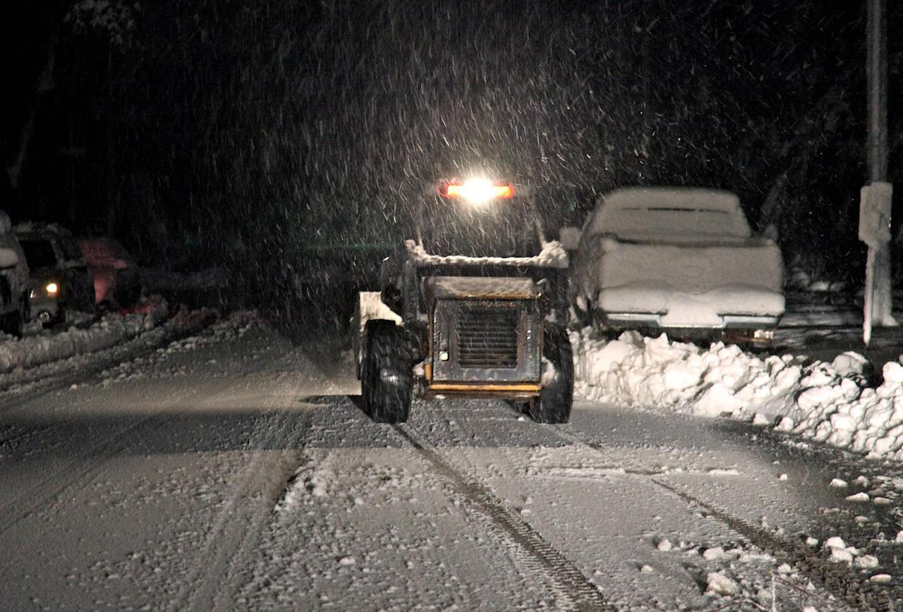 Snow falls in Elkins, W.Va., Tuesday, Oct. 30, 2012, a day after Sandy slammed the eastern coast of the Unites States. In some parts of West Virginia the collision of multiple storm systems could produce up to 3 feet of snow. (AP Photo/Robert Ray)