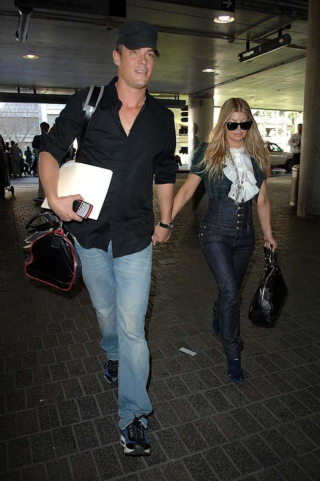 "Newlyweds Fergie and Josh Duhamel jetted off for their honeymoon last weekend following their private Malibu wedding. Canham/Vickers/Seligman/<a href=""http://www.splashnewsonline.com"" target=""new"">Splash News</a> - January 11, 2009"