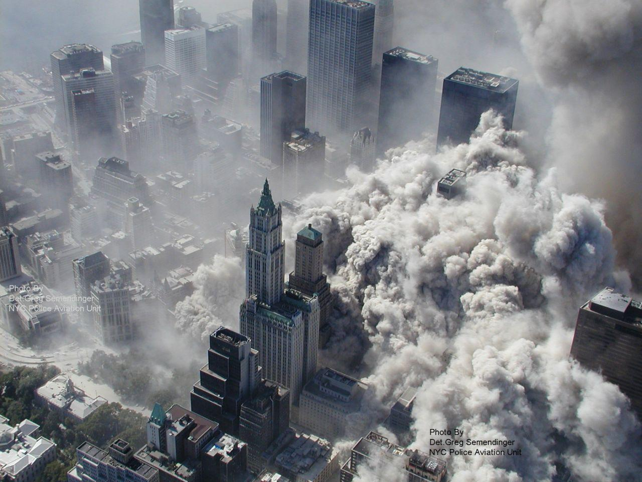 <p>A photo taken on September 11, 2001 by the New York City Police Department as the North Tower collapses, engulfing lower Manhattan in smoke and ash. <br /><br />(Photo: AP Photo/NYPD, Det. Greg Semendinger)<br /><br /></p>