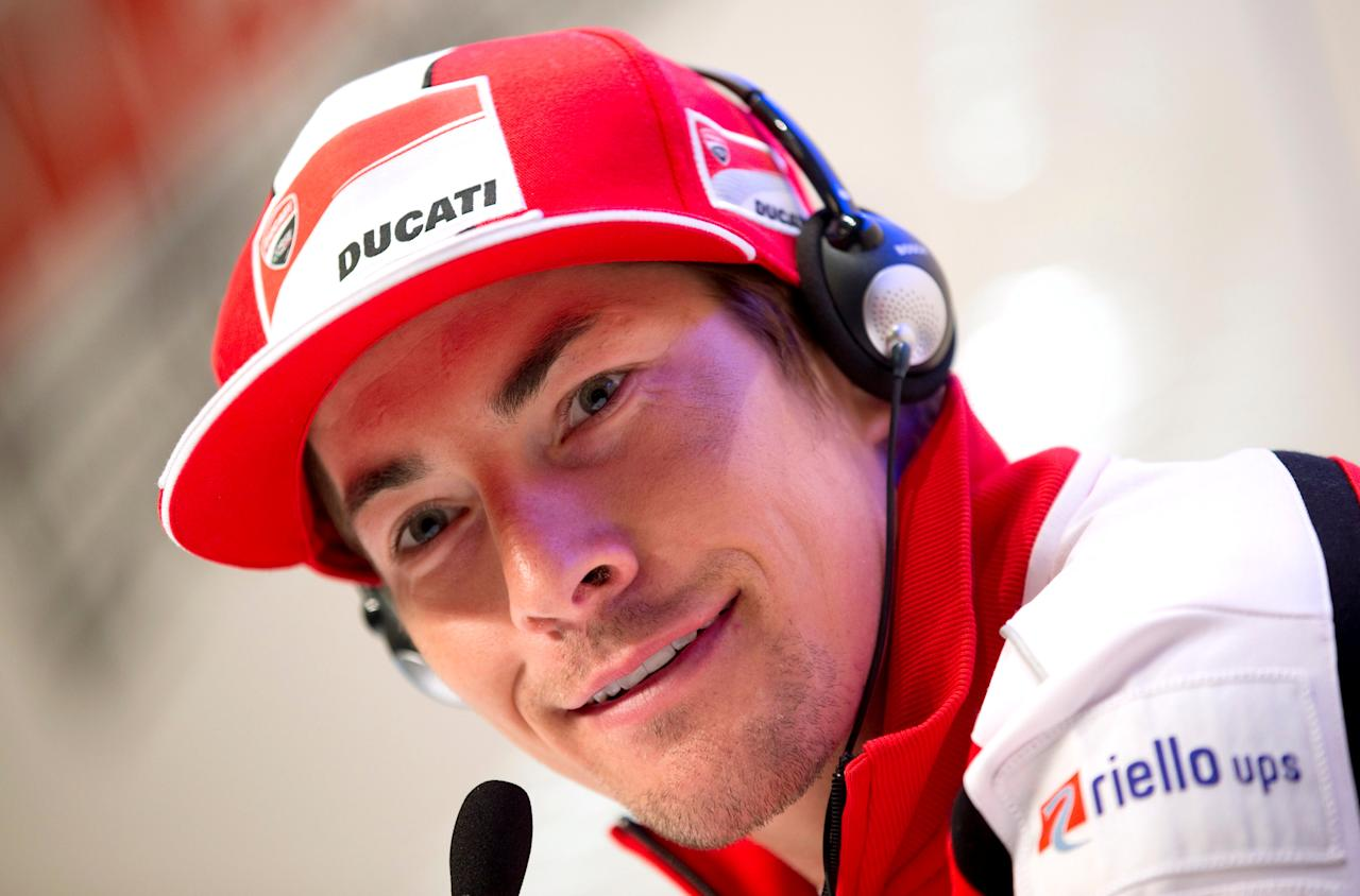 FILE PHOTO - Ducati MotoGP rider Nicky Hayden of the U.S. smiles during a news conference at the Wrooom, F1 and MotoGP Press Ski Meeting, Ducati and Ferrari's annual media gathering, in Madonna di Campiglio January 15, 2013. REUTERS/Max Rossi/File Photo